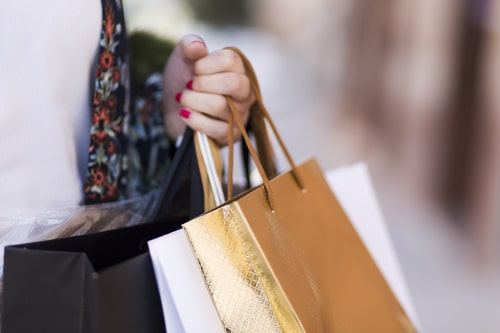 hand-carrying-paper-bags
